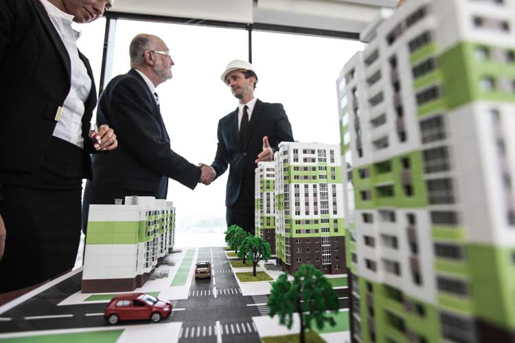 Building owners sell above market price to alternative energy real estate group